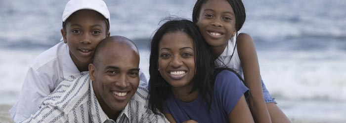 Portrait of smiling family on the beach