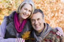 Portrait of an older couple outdoors in autumn