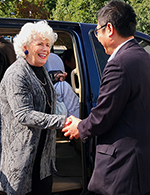 Chris MacDonell is greeted in China