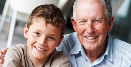 Portrait of smiling grandfather and grandson