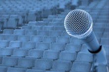 A microphone in front of an auditorium