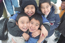 Four First Nations children outdoors in winter