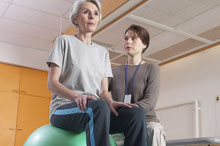 Physical therapist working with a woman