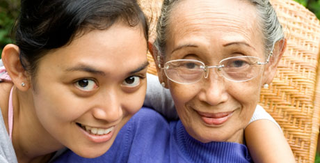 Young woman with her arm around her smiling grandmother