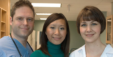 Portrait of three coworkers in a medical setting